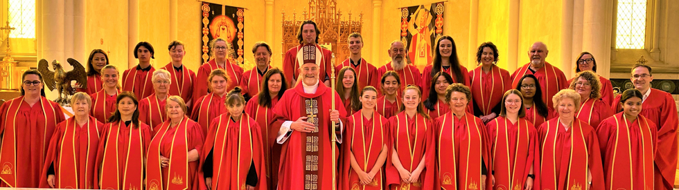 Sacred Heart Cathedral Choir members with Bishop Shane Mackinlay after 11am Mass on Passion/Palm Sunday, 28 March 2021. Photo:  Francine Mills & Sarah Gould